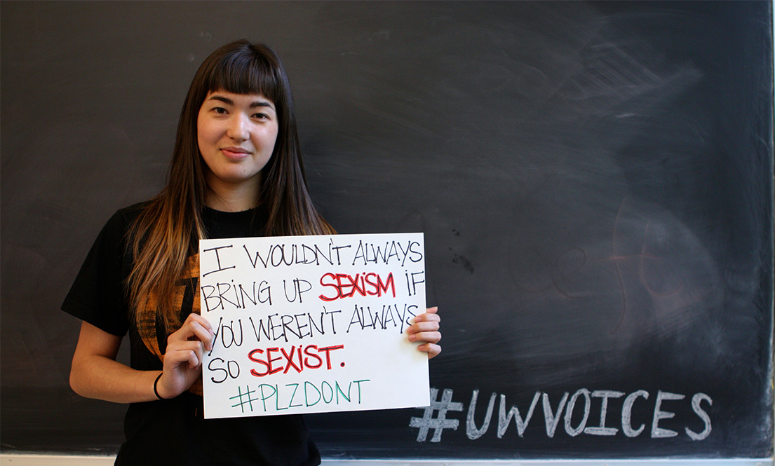 Student holding sign addressing sexism
