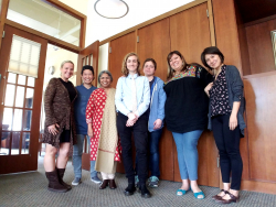 Logan O Laughlin with faculty and friends post-dissertation defense